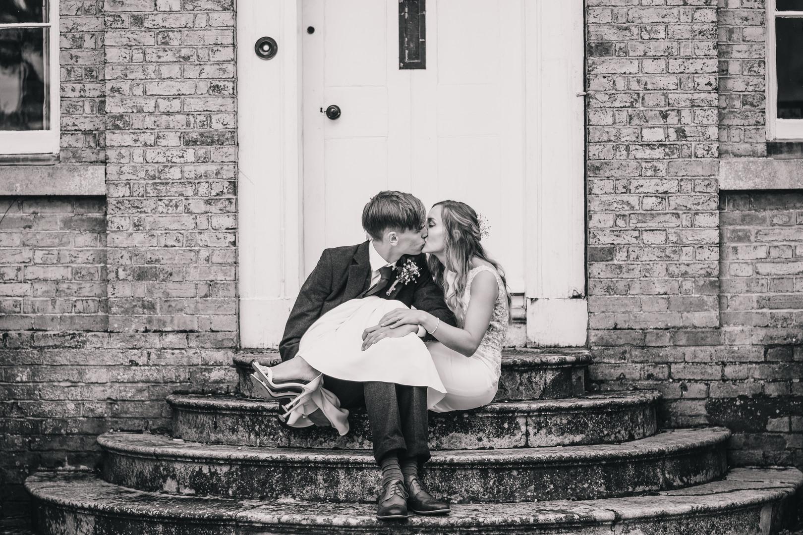 kissing on stairs at Barnston Lodge