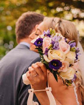 bride holding boquet at wedding