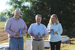 Slade and Kristie pictured with State Senator with their award winning honey