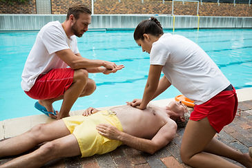 Lifeguards pressing chest of unconscious