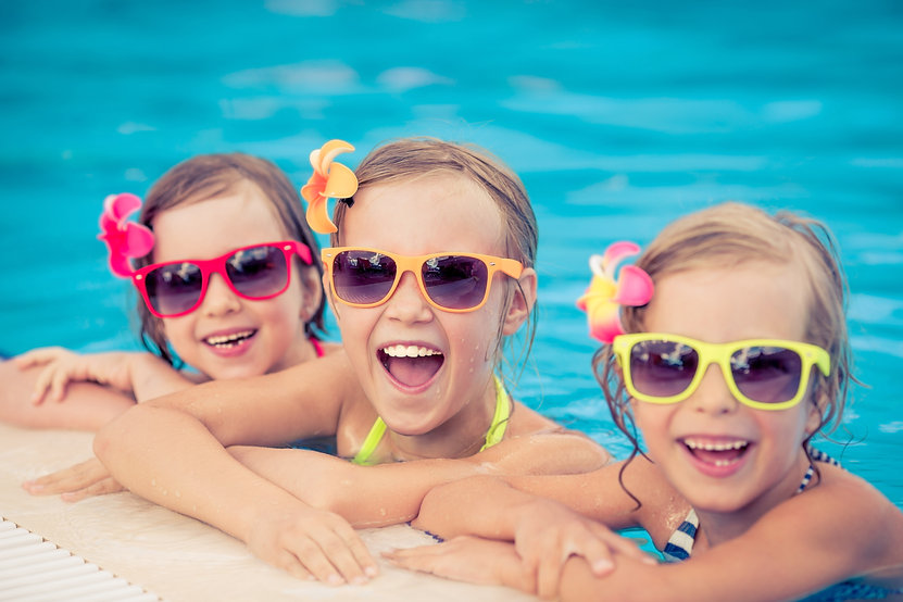 Happy children in the swimming pool. Fun
