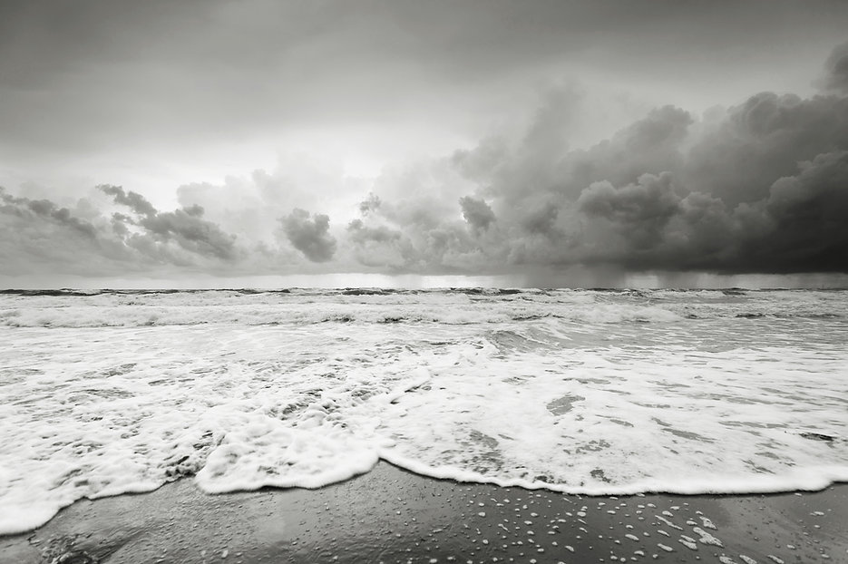 Cloudy beach before raining in black and