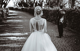 A girl dressed in a wedding dress on the