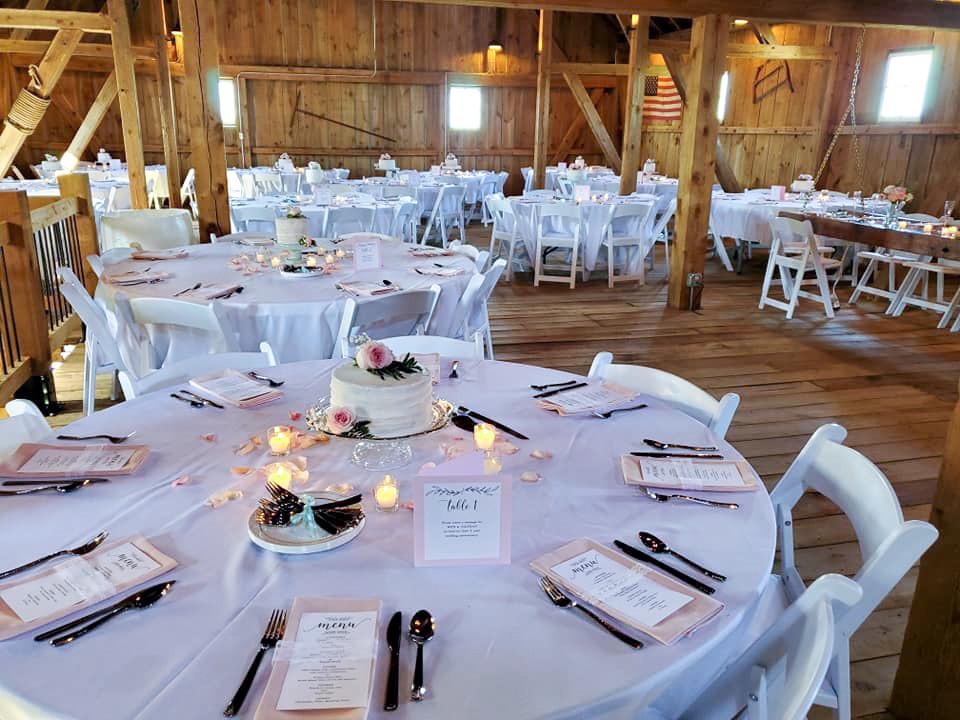 Barn wedding reception setup at The Barn at Double K Ranch