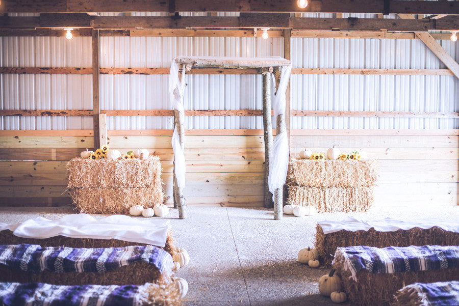 Rustic barn wedding ceremony setup