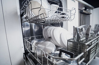 Clean dishes in dishwasher machine after