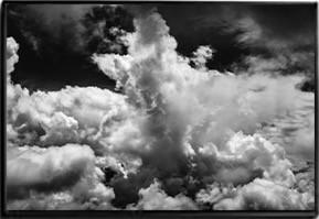 White clouds in a dark sky
