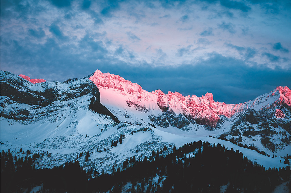 Pink lit mountain tops in Villars sur Ollon