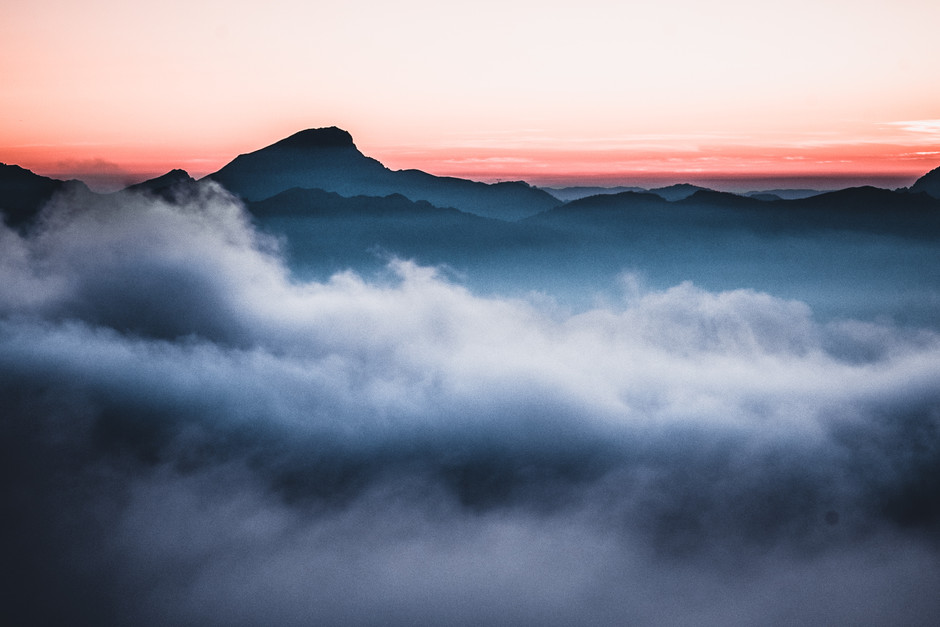 Mountain above clouds