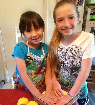 Kids making lemon bars