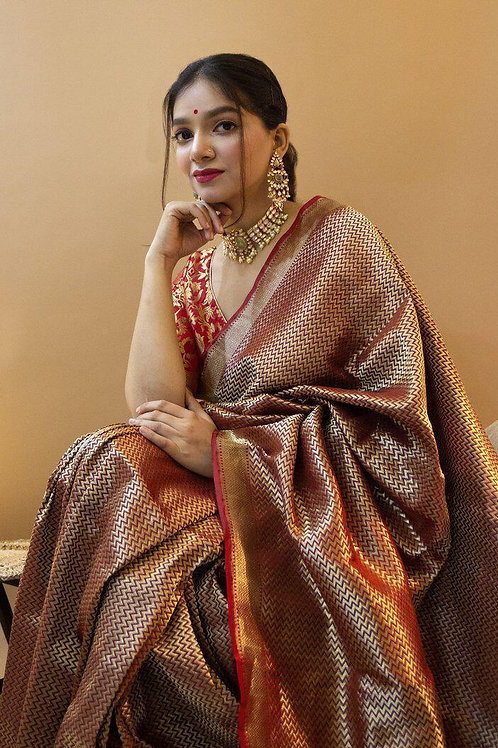 Banarasi silk saree with royal motifs of pejalis