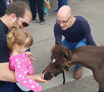 Medical Center Triple B Foundation For Pet Therapy miniature horse Baxter greeting a special friend