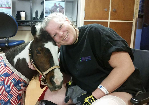 Triple B Foundation miniature horse Domi providing pet therapy to client at St. Alphonsus Boise Medical Center rehab