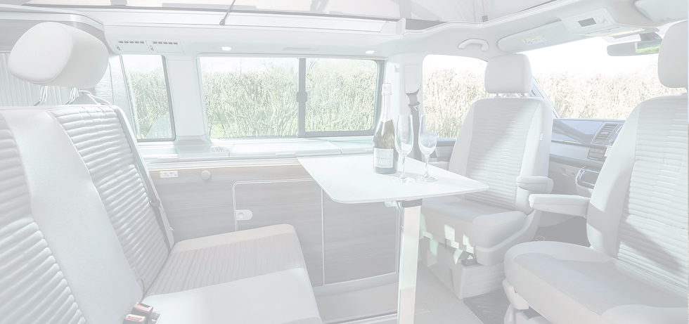 Interior of VW California Dining Area with Champagne & Glasses on Table
