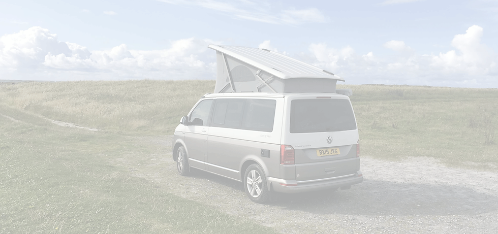 Silver VW California Van with Roof Up in Countryside