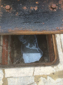 Blocked manhole chamber in Blackpool
