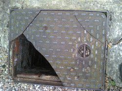 Damaged Manhole Cover Lancashire - JCS Drainage