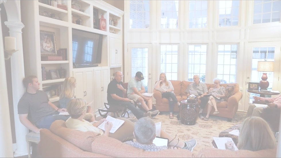 Group of adults sitting on couches around a living room with their Bibles open as they have an in-depth discussion together.