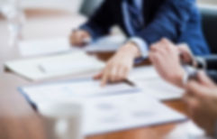 iStock-business-meeting-executive-papers