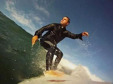 Fr.Calloway_surfing.jpeg