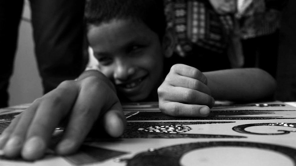 Visually blind kid using tactile art