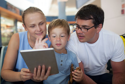 parents-and-son-with-tablet-pc-at-the-ai