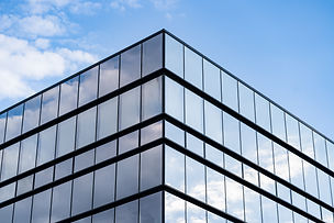 modern-glass-building-architecture-with-blue-sky-clouds.jpg