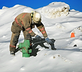 Fireman in Snow Drift with Fire Hydrant