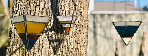 Glass hangers in tree