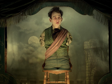 A reading of quotes by the artist in Meal Ticket short in The Ballad of Buster Scruggs