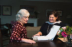 Older woman and Diana Cable discuss aging at home.