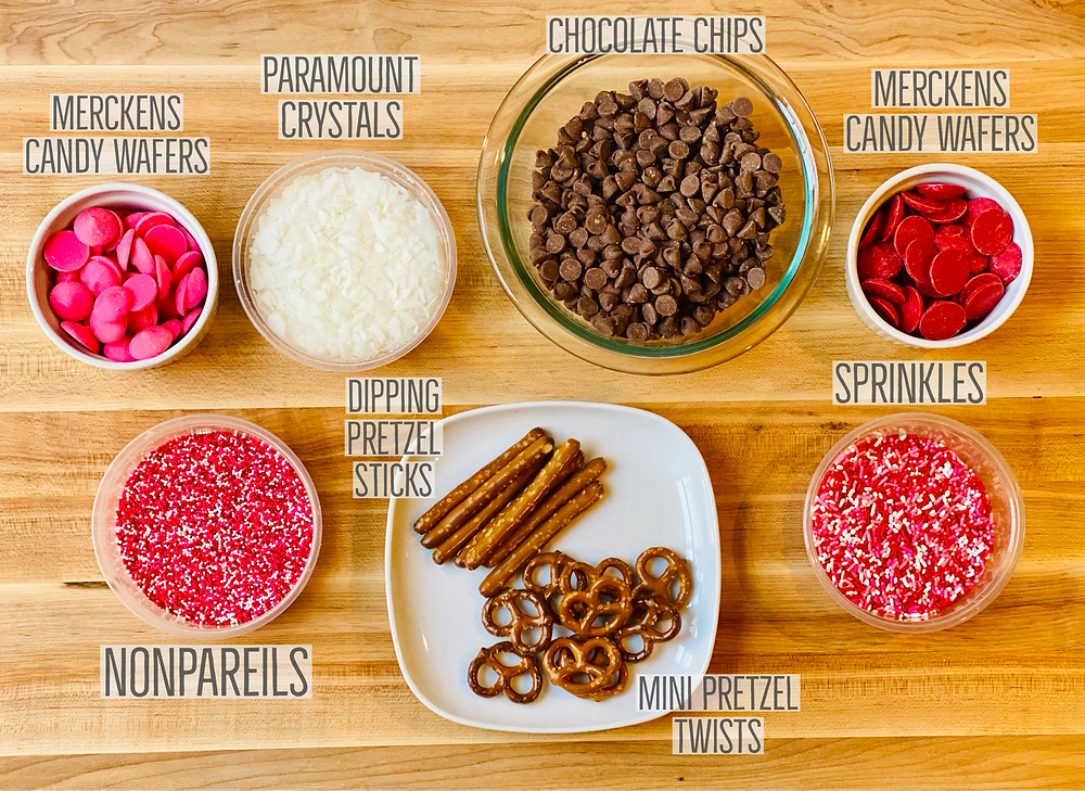 Ingredients including nonpareils, sprinkles, jimmies and candy wafers, to use when making chocolate covered pretzels
