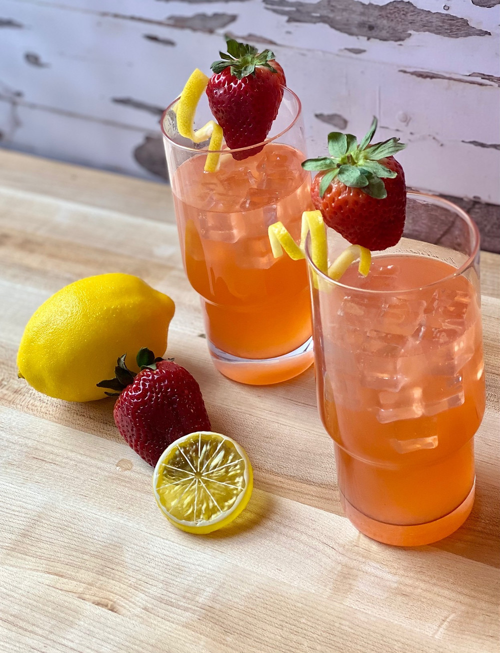 Refreshing cocktails consisting of tequila, strawberry lemonade and lemon and strawberry simple syrup. Garnished with a strawberry and twist of lemon peel.