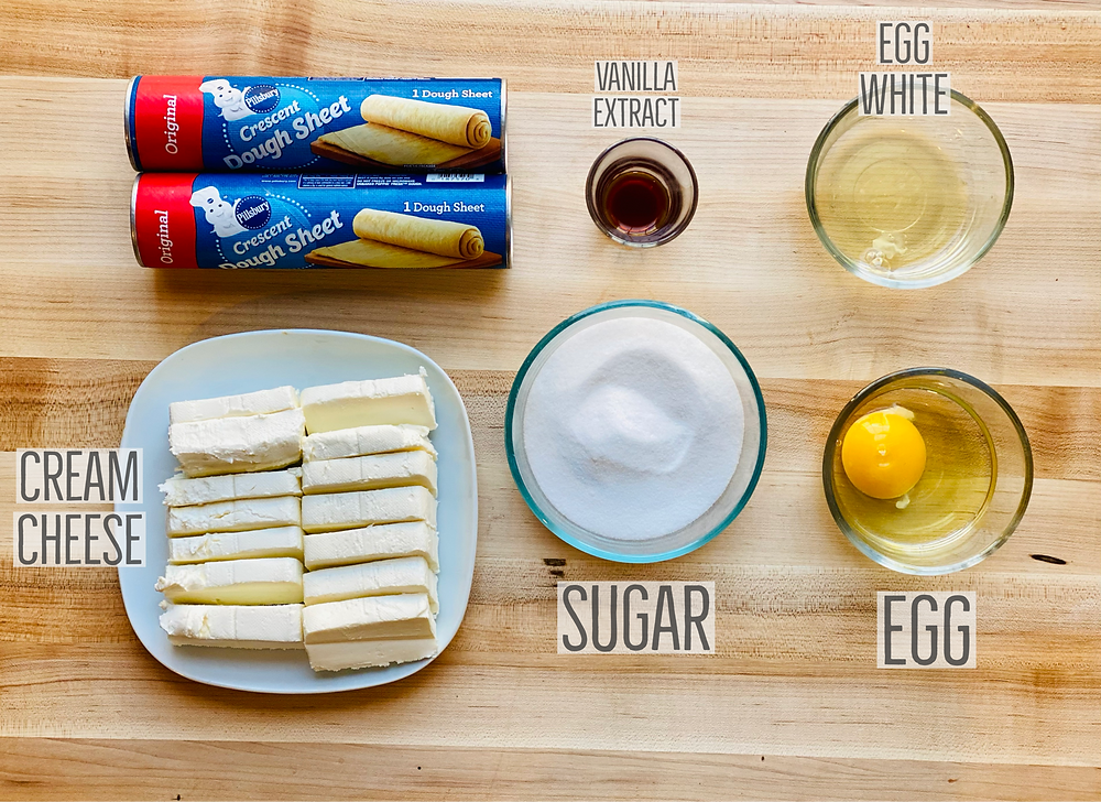ingredients for cream cheese apple danish from Desserts Capital delivery based online bakeshop in Philadelphia, Pennsylvania which includes Pillsbury crescent dough sheets, philadelphia cream cheese bars, granulated sugar, vanilla extract, whole egg and egg white