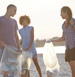 Volunteers Collecting Trash on Beach