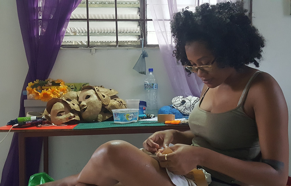 Shanice Smith works on a series of masks for one of several projects she is currently developing