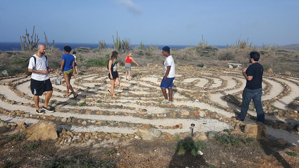 Participants of Caribbean Linked IV walk through the Alto Vista Peace Labyrinth