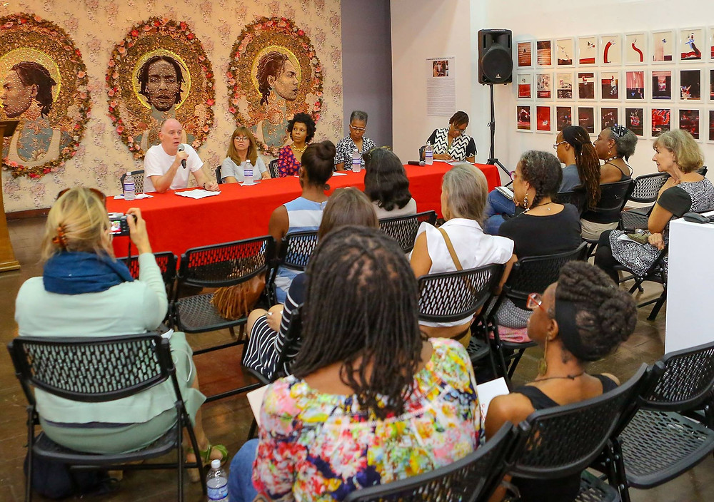 As part of the accompanying programmes for `We Have Met Before', the National Gallery of Jamaica and the British Council presented a panel discussion on the issues raised by the exhibition on Saturday, September 23. The panel consisted of three of the artists in the exhibition, Graham Fagen, Joscelyn Gardner and Ingrid Pollard, while Deborah M. Carroll Anzinger spoke about Leasho Johnson's work. The panel was moderated by Shani Roper, Acting Director/Curator of Liberty Hall, the Legacy of Marcus Garvey. Photo courtesy of the British Council