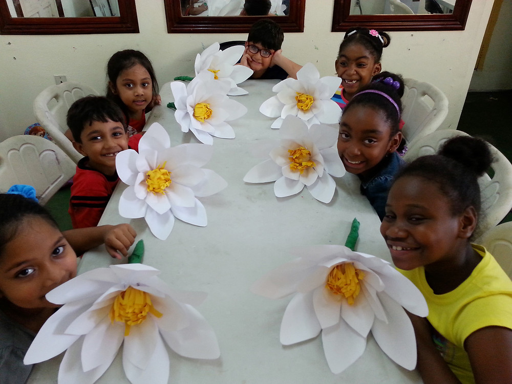 These children were all smiles with their finished paper flowers