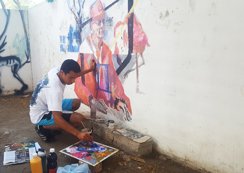 Simon Tatum (The Cayman Islands) works on his mural for the Caribbean Linked IV exhibition