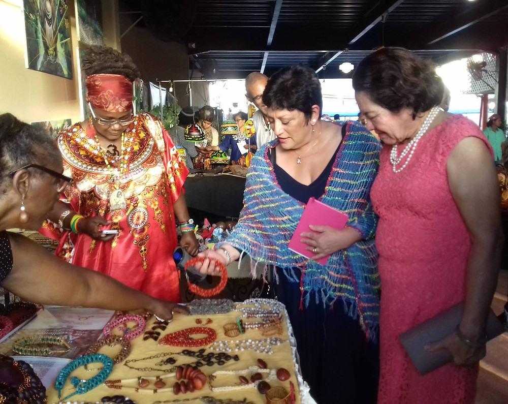 First Lady Sandra Granger and other patrons examine jewellery made by a member of the recently formed Guyana Creative Business Co-op Society, at the two-day Arts Tourism Extravaganza event last month. The event was a collaborative effort between the co-op society, the Tourism and Hospitality Association of Guyana and Roraima Duke Lodge.