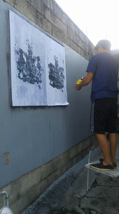 "Kriston Chen installs Caymanian artist Simon Tatum's ""Coat of Arms"" submission for Toofprints at Alice Yard, Woodbrook. Simon Tatum is a fellow CLIV participant from last year's iteration in Aruba. Toofprints is a project based in Trinidad that explores contemporary graphic design in a public space"
