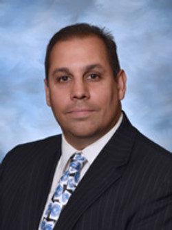 Dr. Chris Delgado