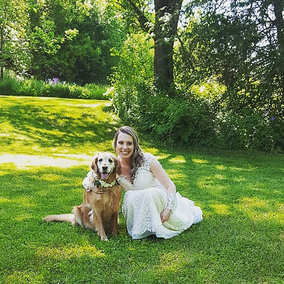 bride and dog on wedding day