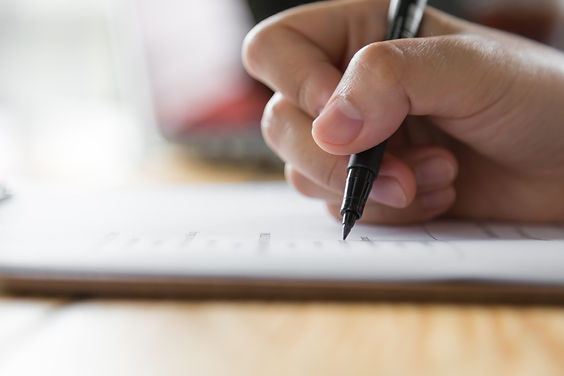 hand-writing-paper-with-pen.jpg