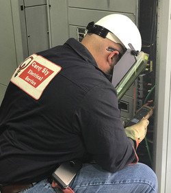 Commercial Electrician Performing Panel Inspection for Arc Flash Boundary