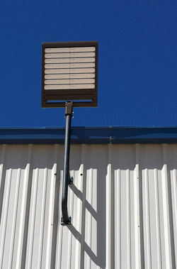Installation of LED Security Light Fixture on Commercial Building