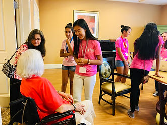 GirlsInSTEM Members Serving Seniors.JPG