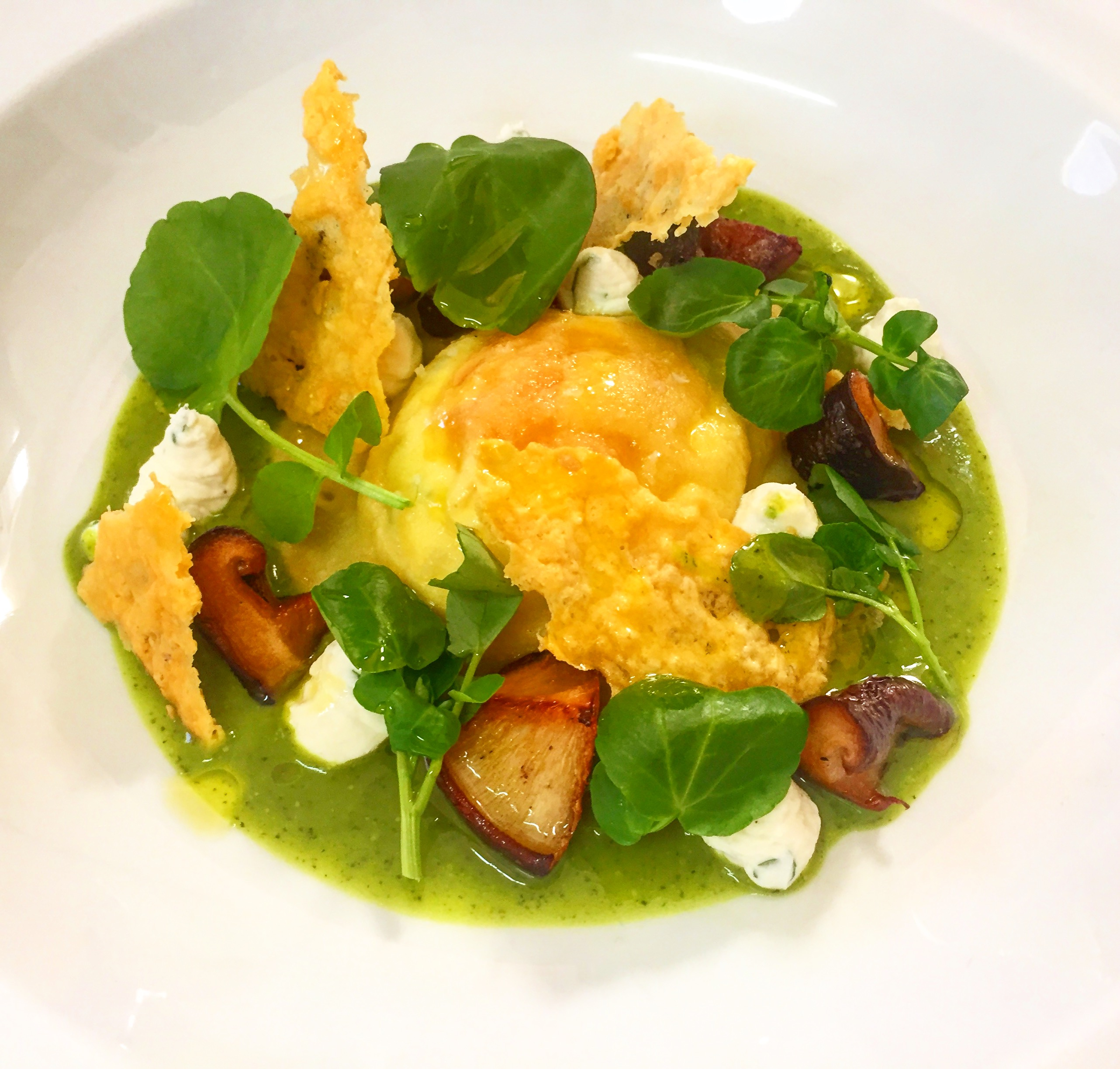 Egg yolk ravioli, watercress veloute