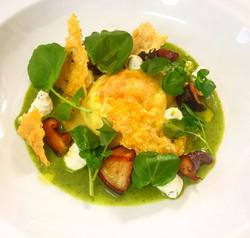 Egg yolk ravioli, watercress veloute